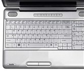 Ноутбук Toshiba Satellite L500-1UK <PSLS0E-06D02URU> 15.6 HD (1366x768) LED/Pentium T4400 (2.20GHz) 800MHz/2GB DDR3 (1066MHz)/320GB/DVD±RW/Mobile Intel GMA 4500M/WiFi/NoBT/0.3Mpix/Win7 32bit HB/Aluminium Silver2, A4 KB + num. Keypad - Silver painted
